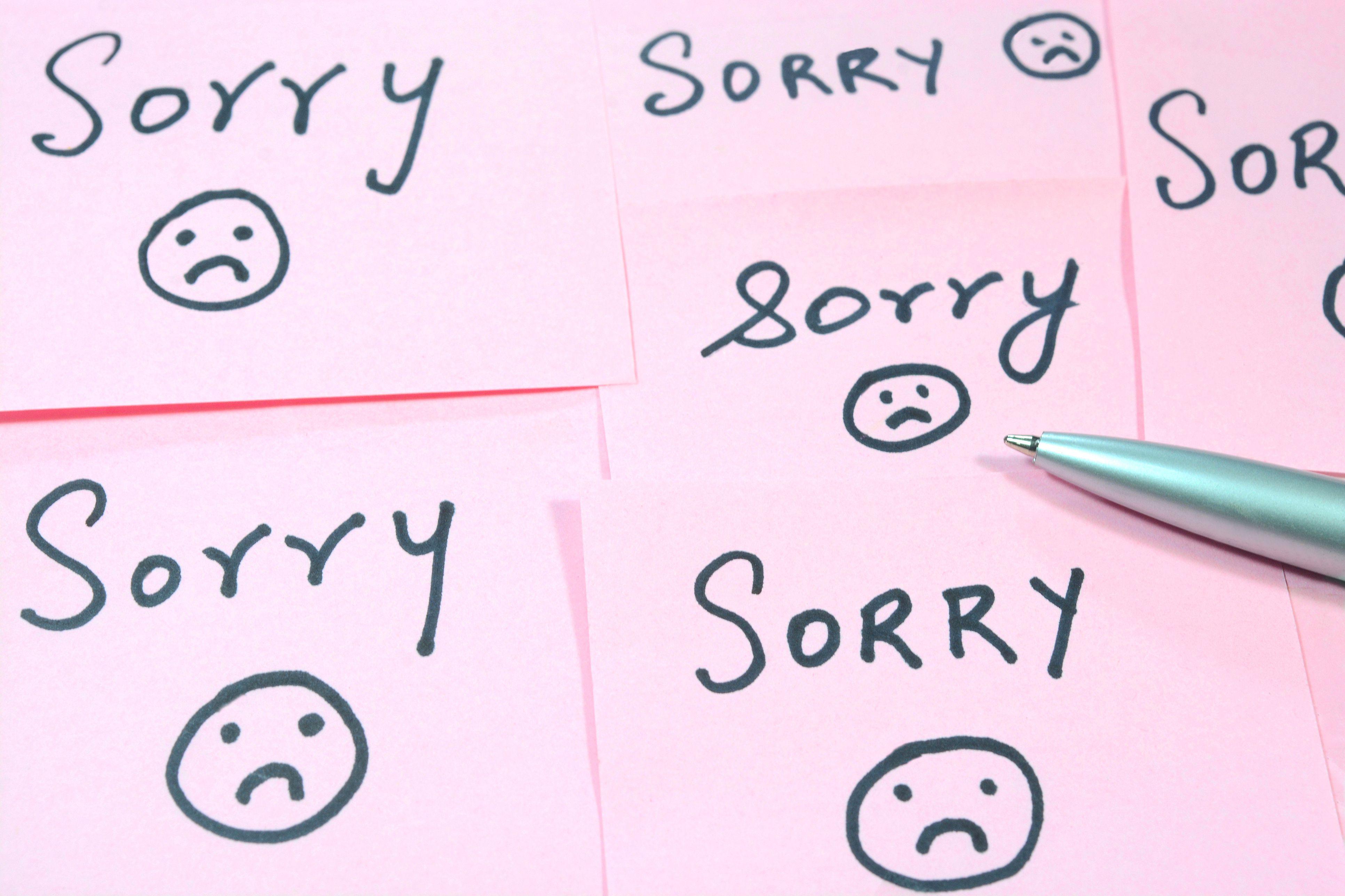Hình ảnh trang giấy viết các chữ sorry