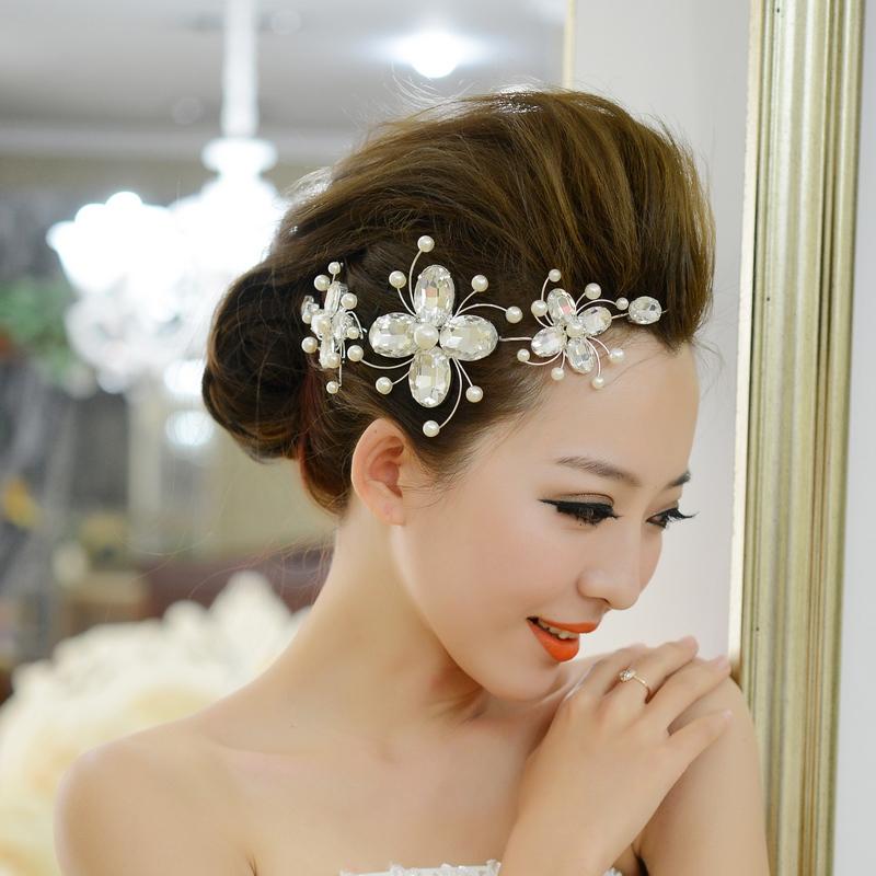 Kiểu tóc cô dâu búi cao đẹp trong ngày cưới
